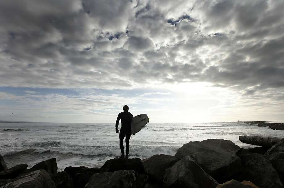 Bryce Adams prepares to jump into the chilly surf south of Pillar Point. Photo: Lance Iversen, The Chronicle