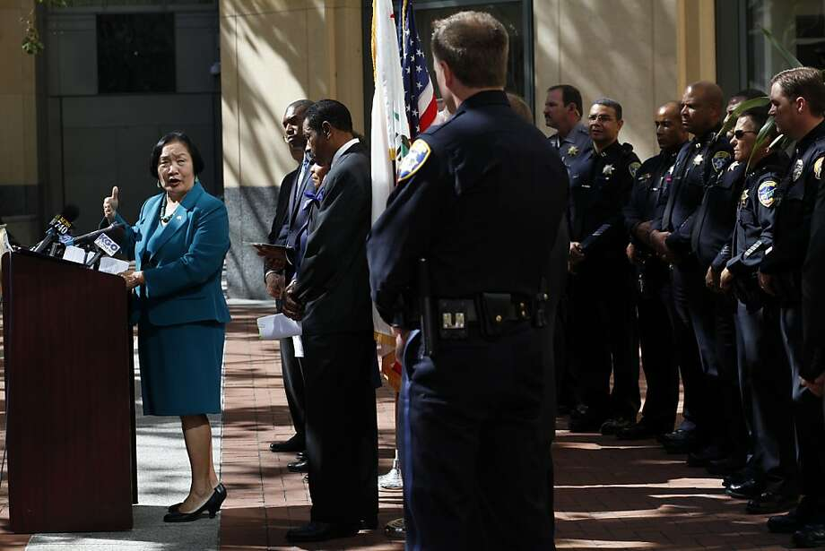 Mayor Jean Quan thanks Oakland police for all their hard work at a news conference, attended by Rep. Barbara Lee and Associate Attorney General Tony West, announcing a federal grant to hire more officers. Photo: Lacy Atkins, The Chronicle