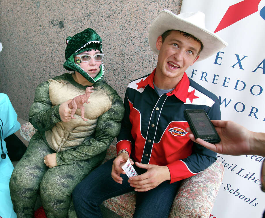 Sandra Calderon and Nick Savelli showed up in costume for the Texas Freedom Network's rally outside the hearing on textbook content. Photo: Tom Reel, San Antonio Express-News
