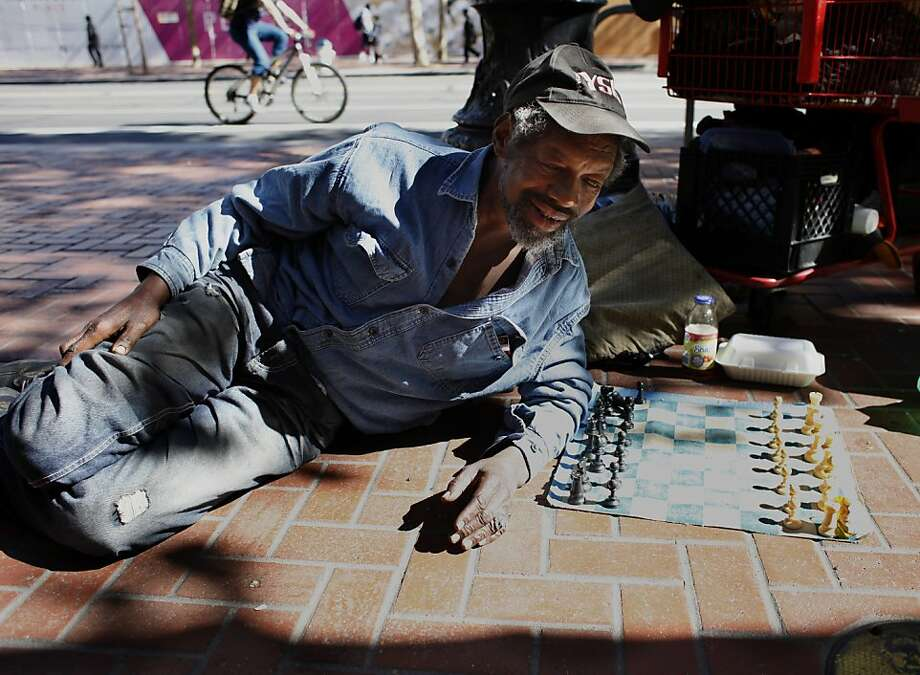 Marvin Boykins, 57, rests on the sidewalk between 5th and 6th and Market Street with his chess board waiting for a competitor,  Monday September 16, 2013, in San Francisco, Calif.  Marvin known also as Grand Master learned to play chess when he was 7 years old. Photo: Lacy Atkins, The Chronicle