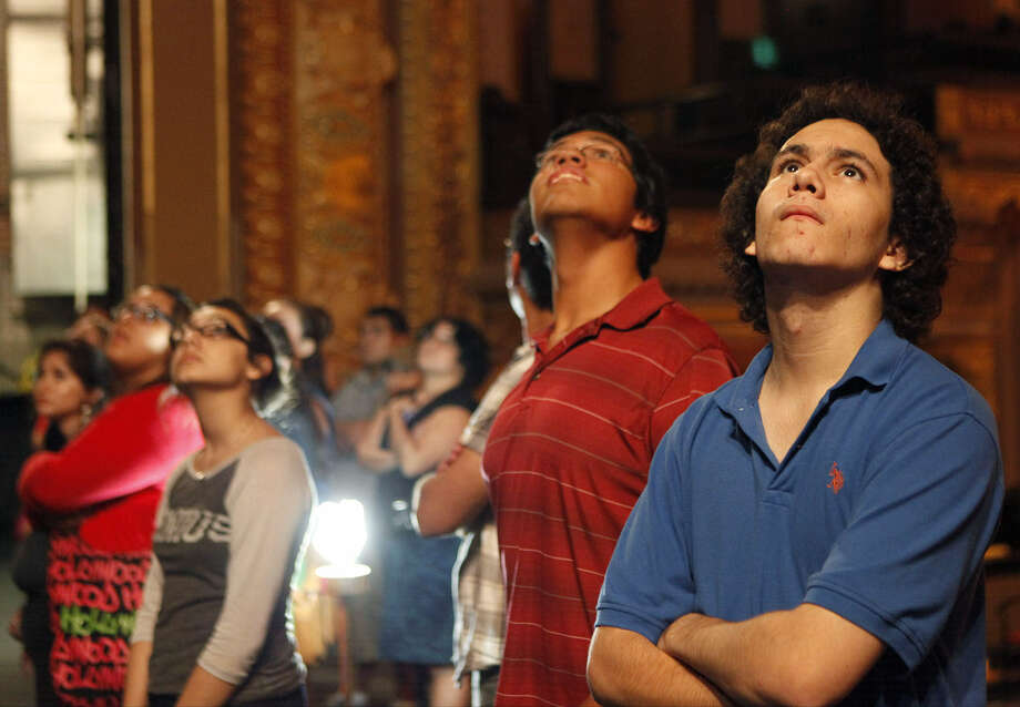 Ike Amador (right) and other students take a tour of the Empire Theatre as part of the Behind the Scenes program. Photo: Cynthia Esparza / For The Express-News