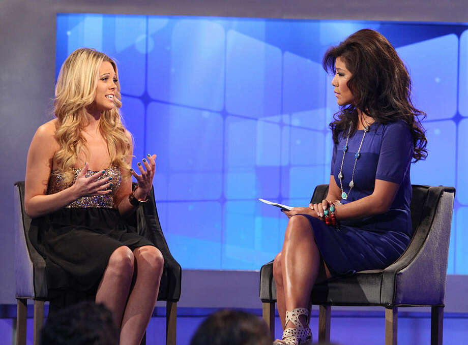 """Big Brother"" houseguest Aaryn Gries is interviewed by show host Julie Chen. Gries made offensive remarks about housemates during the series and later apologized. She wasn't alone in being offensive. Photo: CBS Via Getty Images"