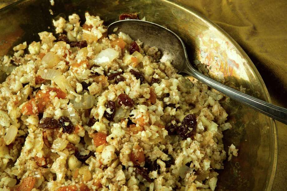 Paleo Rice Pilaf replaces the rice with cauliflower. Photo: Brett Coomer, Staff / © 2013 Houston Chronicle