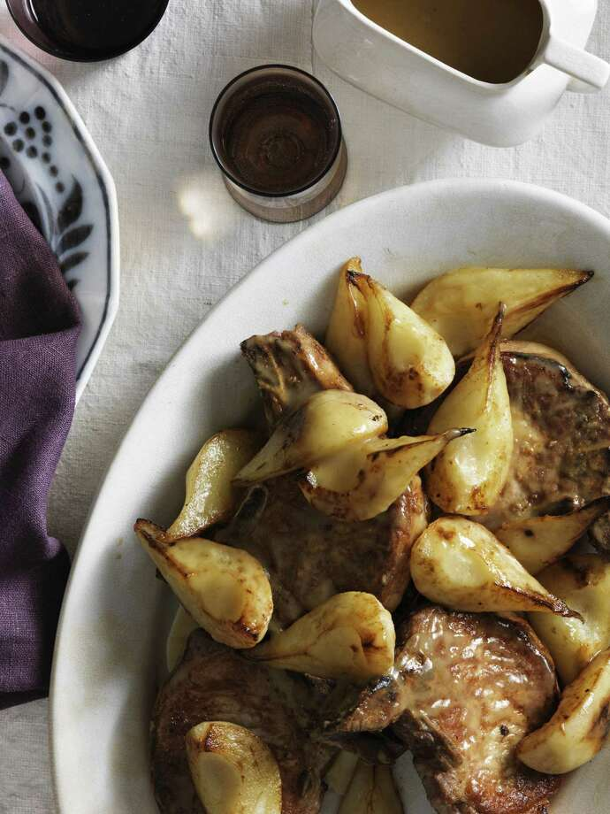 Country Living recipe for Pan-Seared Pork Chops with Rosemary and Pears. Photo: Johnny Valiant