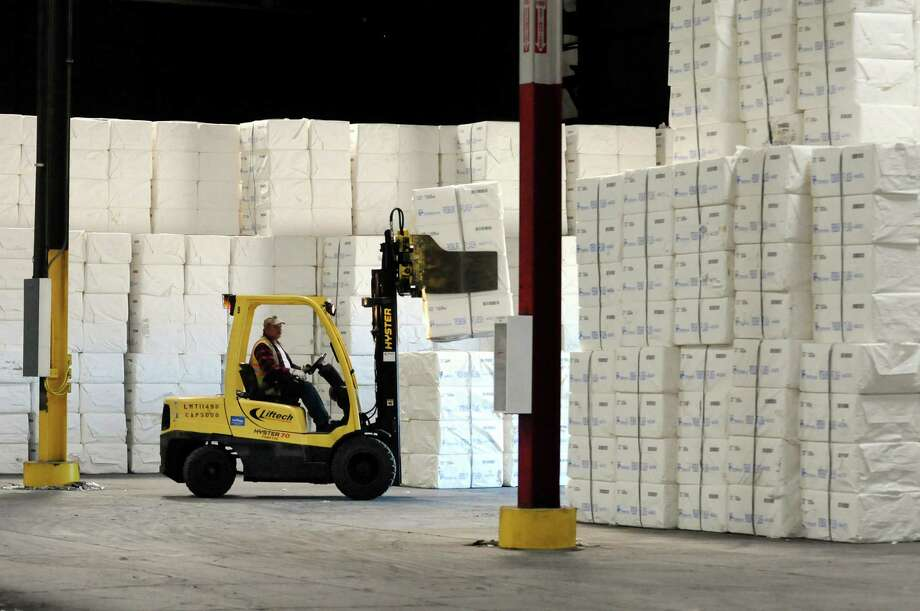 Longshoreman Larry Storm moves packaged wood pulp on Tuesday, Sept. 17, 2013, at the Port of Albany in Albany, N.Y. (Cindy Schultz / Times Union) Photo: Cindy Schultz / 00023902A