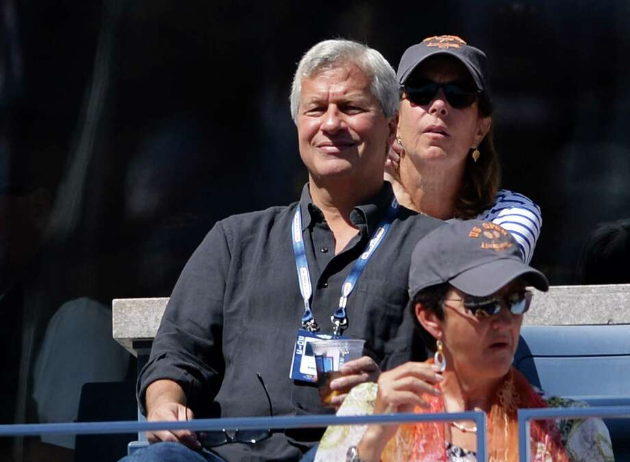 Jamie Dimon (CL), President and CEO of JP Morgan Chase, watches the men's seminfinal match between Novak Djokovic of Serbia and Stanislas Wawrinka of Switzerland during the 2013 US Open at the USTA Billie Jean King National Tennis Center September 7, 2013 in New York. AFP PHOTO/Stan HONDASTAN HONDA/AFP/Getty Images Photo: STAN HONDA, Staff / AFP