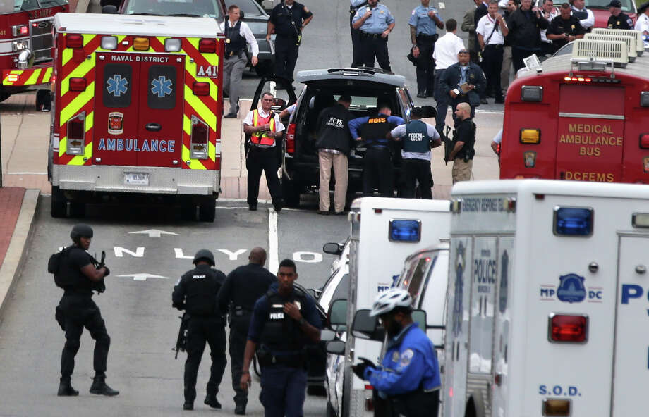 Emergency vehicles and law enforcement personnel respond to the shooting at an entrance to the Washington Navy Yard Monday September 16, 2013 in Washington, DC.  Photo: Alex Wong, Getty Images / 2013 Getty Images