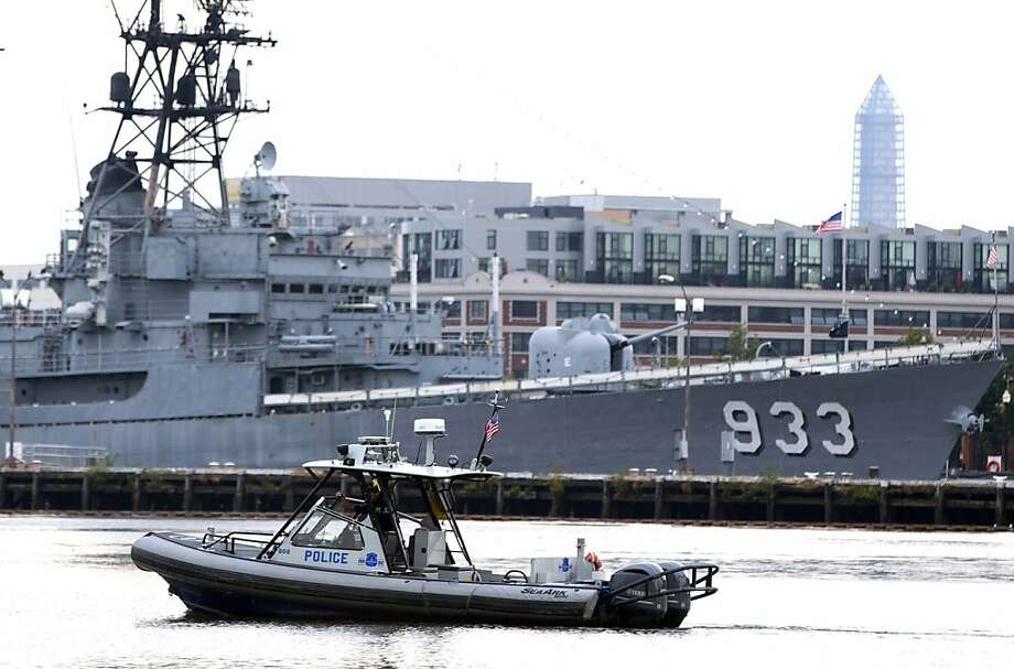 A police boat patrols near the scene of a shooting at the Washington Navy Yard on Monday in Washington. The gunman opened fire inside a building at the Washington Navy Yard. Photo: Evan Vucci, Associated Press