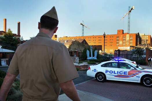 Only essential personnel are allowed into a closed Washington Navy Yard Tuesday, the day after a gunman launched an attack inside the Washington Navy Yard. Photo: Jacquelyn Martin, STF / AP