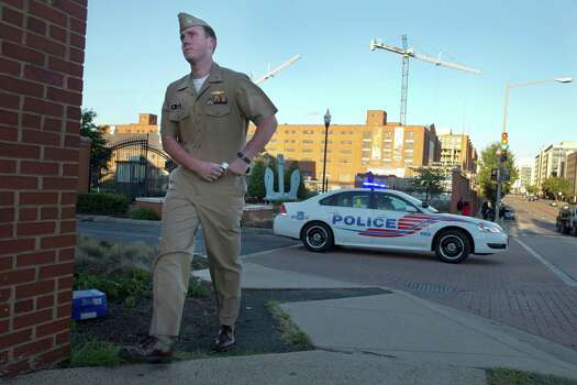 Essential personnel are allowed into a closed Washington Navy Yard in Washington, on Tuesday, Sept. 17, 2013. Photo: Jacquelyn Martin, STF / AP