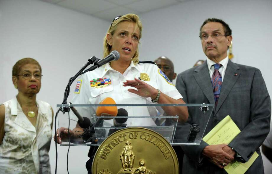 District of Columbia Police Chief Cathy Lanier, center, flanked by Rep. Eleanor Holmes Norton, D-D.C., left, and District of Columbia Mayor Vincent Gray, right, briefs reporters on the shooting at the Washington Navy Yard. Photo: Susan Walsh, STF / AP