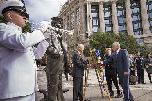 Defense Secretary Chuck Hagel, right, and Joint Chiefs Chairman Gen. Martin Dempsey, second from right, present a wreath at the Navy Memorial in Washington to remember the victims of Monday's deadly shooting at the Washington Navy Yard. Photo: J. Scott Applewhite, Associated Press