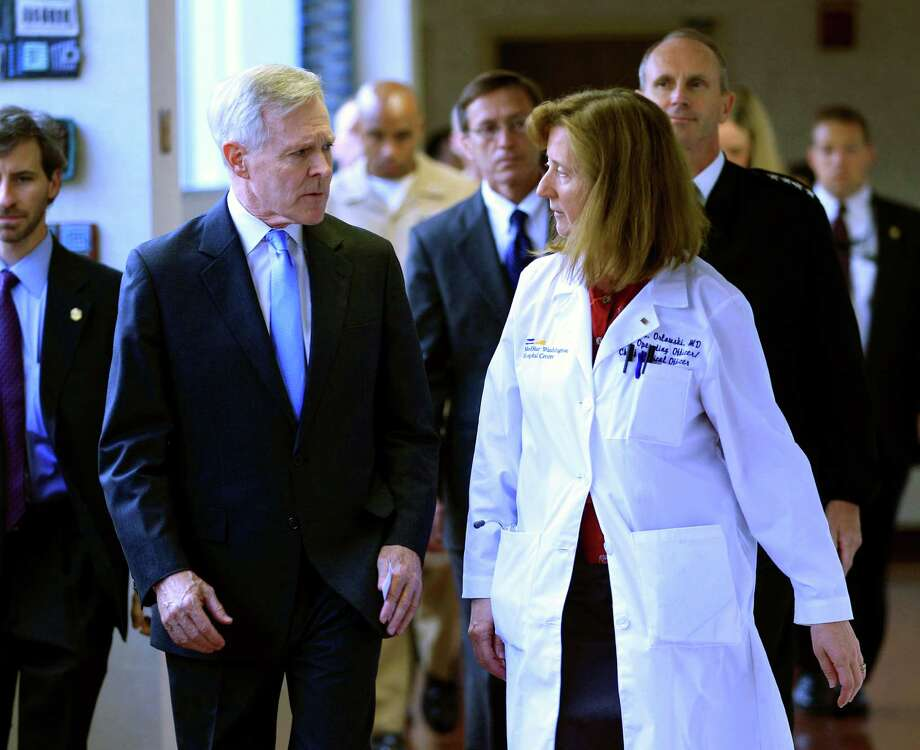Secretary of the Navy Ray Mabus speaks with Dr. Janis M. Orlowski as they walk in the corridor at Washington Hospital Center, in Washington, on Monday, after visiting the people injured in the shooting at the Washington Navy Yard.  Photo: Jose Luis Magana, FRE / FR159526 AP