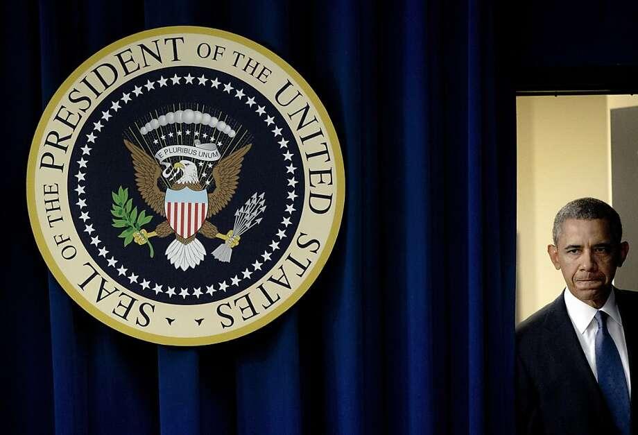 President Barack Obama walks out to speak in the South Court Auditorium on the White House complex, Monday, Sept. 16, 2013, in Washington, about the Washington Navy Yard shooting. Photo: Pablo Martinez Monsivais, Associated Press