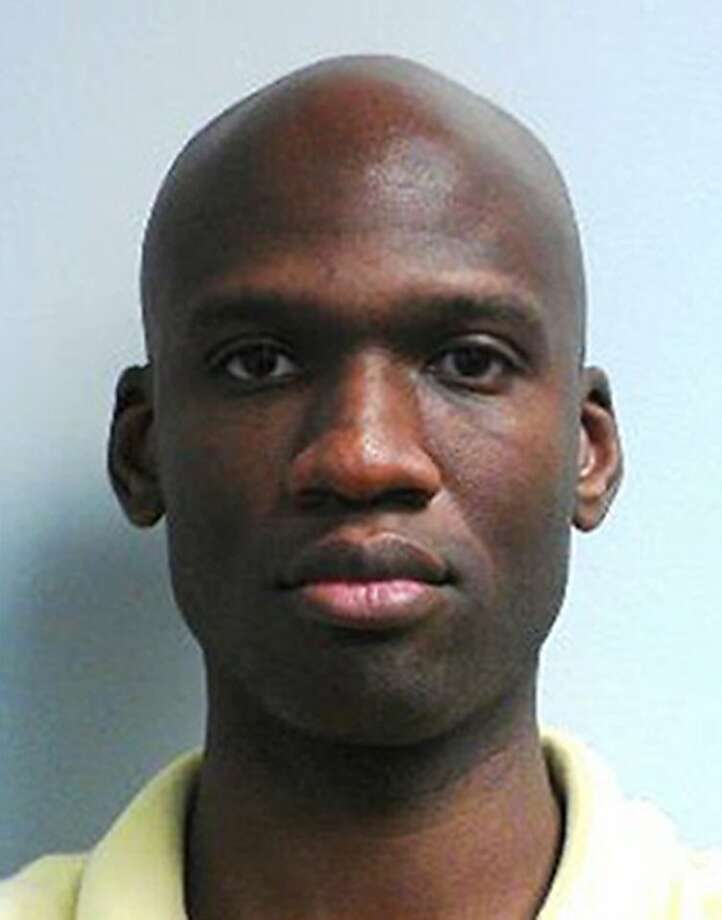 This image released by the FBI shows a photo of Aaron Alexis, the gunman at the Washington Navy Yard shooting in Washington, Monday morning, Sept. 16, 2013, and who was killed after he fired on a police officer.  Photo: Uncredited, Associated Press