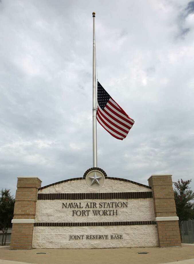 The flag flies at half-staff at the front entrance of the Naval Air Station Joint Reserve Base in Fort Worth, Texas Tuesday, Sept. 17, 2013. Officials say Aaron Alexis, an information technology employee with a defense contractor who once served at this base, used a valid pass to get into the Washington Navy Yard building where he opened fire Monday, Sept. 16, 2013, killing 12 people. Photo: LM Otero