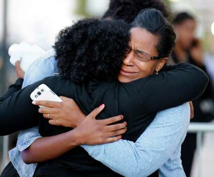 Three women embrace near Nationals Park where family members waited to greet loved ones that were at the Washington Navy Yard, Monday Sept. 16, 2013, in Washington.  Photo: Alex Brandon, STF / AP