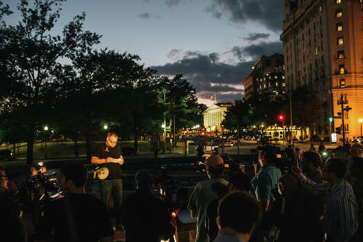 Eddie Weingart of Project End Gun Violence speaks to members of the media during a candlelight vigil at Freedom Plaza on September 16, 2013 in Washington, DC. The vigil, during which Weingart called for stricter gun laws, was in remembrance of the 12 victims killed in a shooting at the Washington Navy Yard earlier in the day. Photo: Greg Kahn, Getty Images / 2013 Getty Images