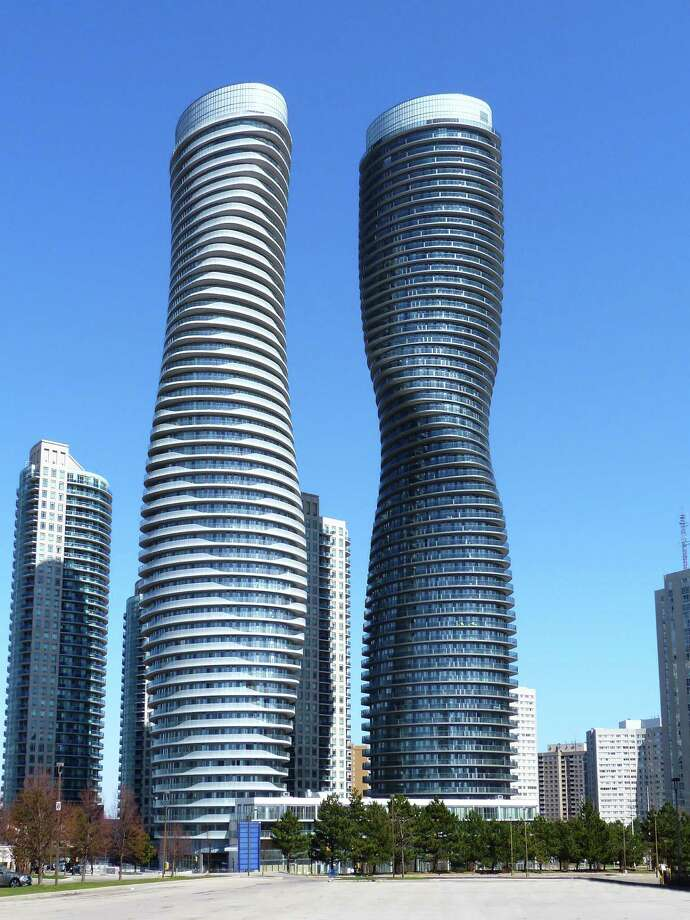 "Twin towers just outside of Toronto are the best new skyscraper project of last year, building data company Emporis announced Tuesday. The Emporis Skyscraper Award -- ""The world's most renowned architecture prize for skyscrapers,"" according to Emporis -- went to Absolute World Towers, in Mississauga, Ontario. An international jury of experts chose the project over more than 300 others at least 100 meters tall completed last year.Click on to see and read more about the Absolute World Towers and the runners up in the competition. Photo: Edvard Mahnic"