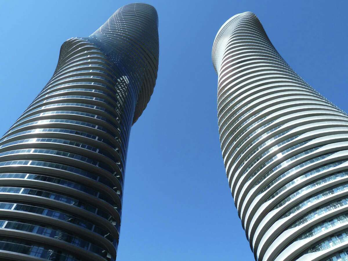 Absolute World Towers were designed by the architectural practices MAD and Burka Architects.