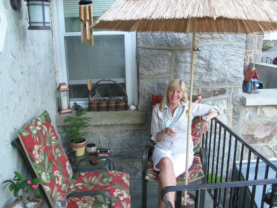 Terry Vanderheyden enjoys her tropical porch on Ledge Avenue. September 17, 2013. New Canaan, Conn. Photo: Tyler Woods
