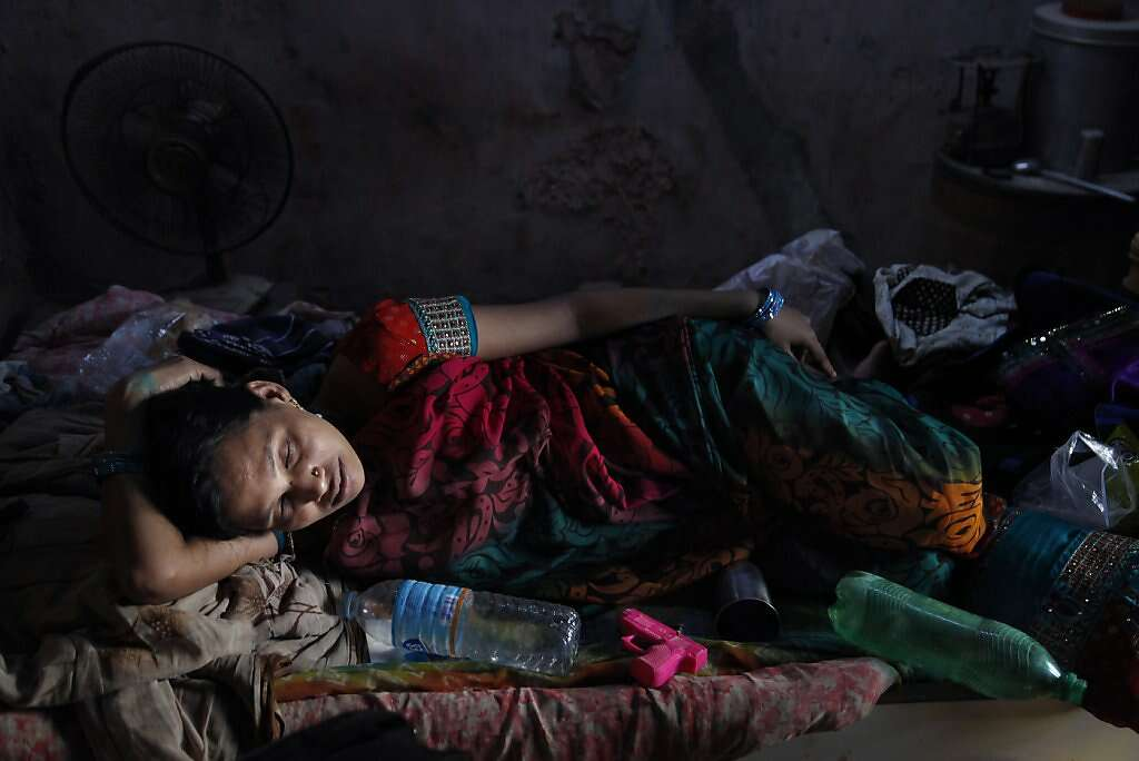 Manisha Parmar rests after her two-hour journey from  the Akanksha Infertility Clinic in Anand to their home Khambhat, India, Monday, June 3, 2013. She received a chilly reception from family and neighbors upon her arrival at home. Surrogacy is culturally stigmatized in her community, although several other women in the area became surrogates before Manisha. Photo: Nicole Fruge, The Chronicle