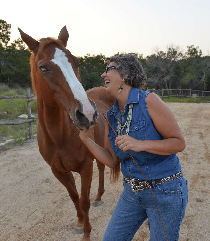 Silvia Sitters works with one of her horses, Cinammon, at the Equi-sol Healing Center near Comfort, Texas. Photo: Robin Jerstad, Freelance