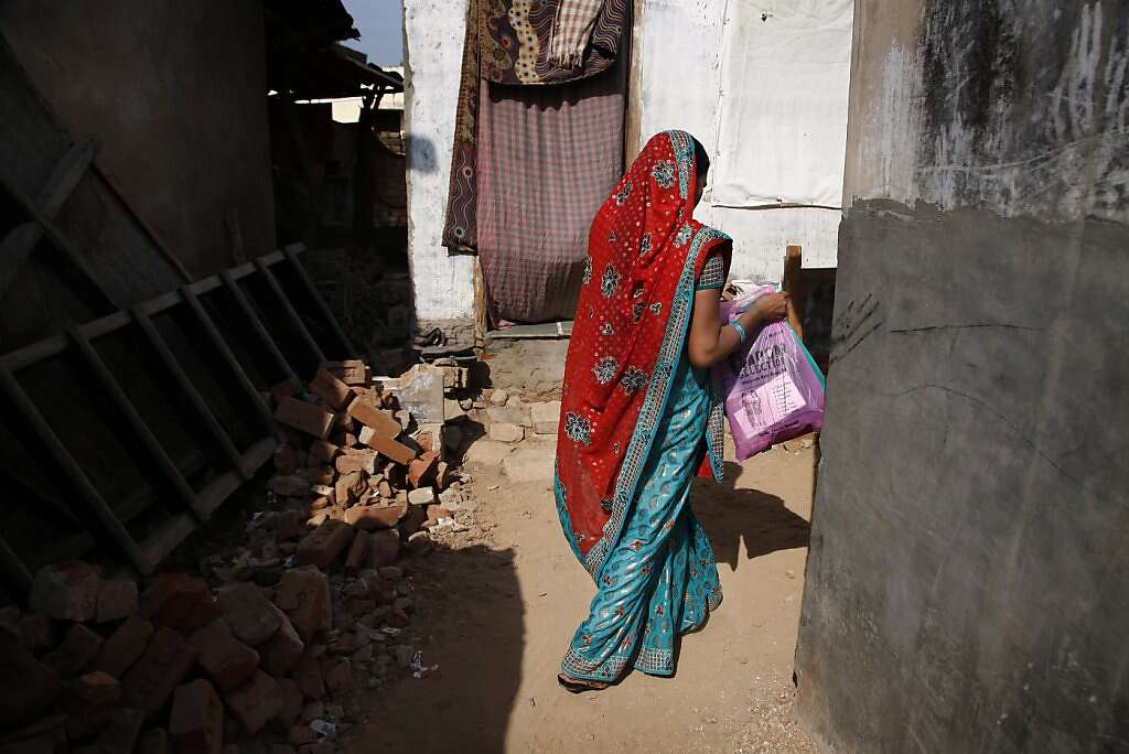 Manisha Parmar returns to her home in Khambhat. The reception from her neighbors and family was chilly. Surrogacy is culturally stigmatized in her community, although several other women in the area became surrogates before Manisha.