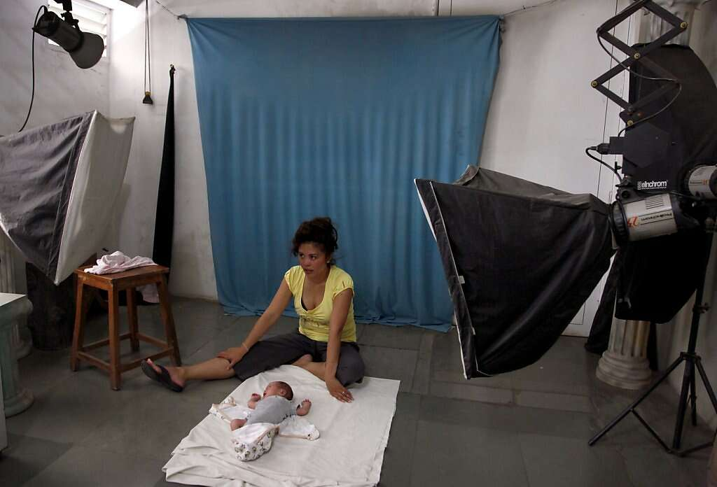 Jennifer Benito-Kowalski takes baby Kyle to get his first passport at a photo studio in Anand, India, Friday, May 31, 2013. Photo: Nicole Fruge, The Chronicle