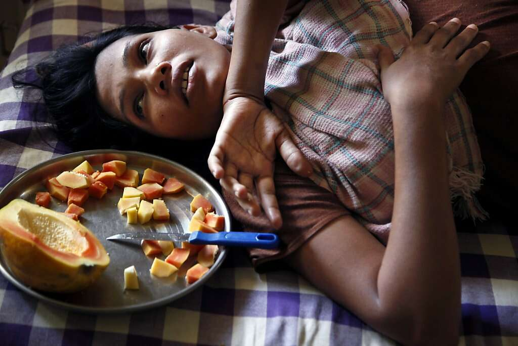 Manisha Parmar has little appetite three days after a Caesarean section at the Akanksha Infertility Clinic, Sunday, May 26, 2013, in Anand, India. Photo: Nicole Fruge, The Chronicle