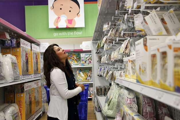 Jennifer Benito-Kowalski shops for last-minute supplies for a 3 1/2-week trip to India at the Babies R Us store in Redwood City, Calif., Friday, May 17, 2013. The cashier assumed the purchase was for a baby shower because Benito-Kowalski didn't appear pregnant. After years of trying to conceive a child, the Kowalskis paid a surrogate in India to carry their child. Benito-Kowalski took a medication called domperidone to help her produce breast milk, but she was still able to produce only small amounts. Photo: Nicole Fruge, The Chronicle