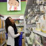 Jennifer Benito-Kowalski shops for last-minute supplies for a 3 1/2-week trip to India at the Babies R Us store in Redwood City, Calif., Friday, May 17, 2013. The cashier assumed the purchase was for a baby shower because Benito-Kowalski didn't appear pregnant. After years of trying to conceive a child, the Kowalskis paid a surrogate in India to carry their child. Benito-Kowalski took a medication called domperidone to help her produce breast milk, but she was still able to produce only small amounts.