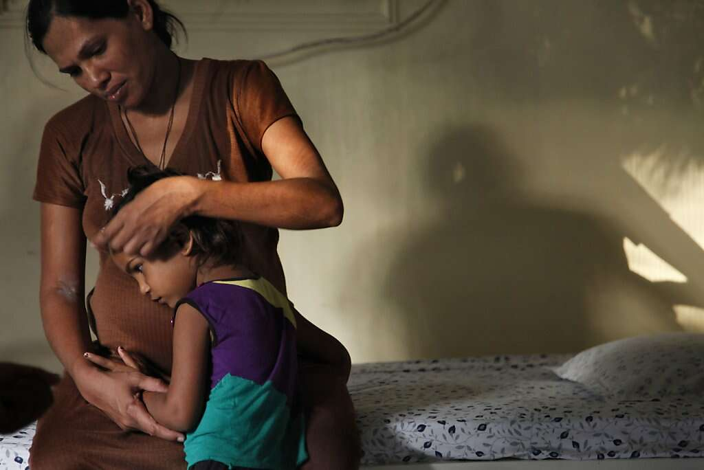 Surrogate Manisha Parmar comforts daughter Urvashi, 3, at the Akanksha Infertility Clinic, Wednesday, May 22, 2013, in Anand, India. Parmar gave birth the next day. Photo: Nicole Fruge, The Chronicle