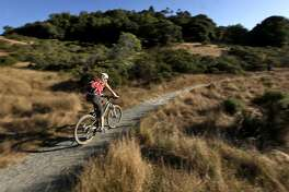 One of the more popular activities seen are the mountain bikers cruising the rolling hills at China Camp State Park on Saturday August 13, 2011, in San Rafael, Ca. China Camp is one of three local State Parks on the closure list which may shut down due to California budget cuts.