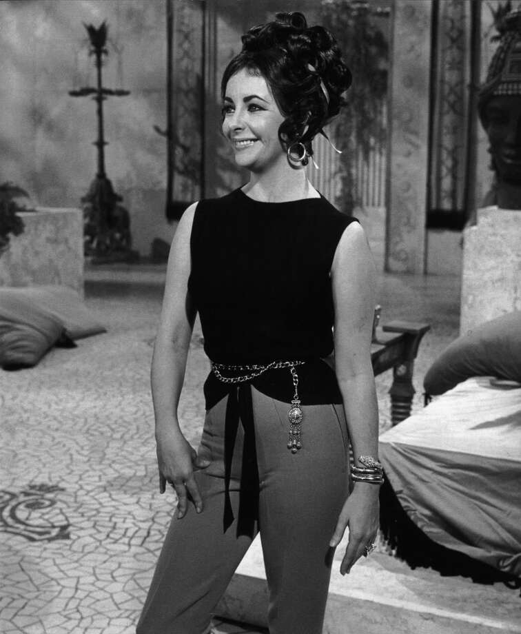 Elizabeth Taylor wearing a Bulgari Serpenti bracelet-watch on the Cleopatra set in 1962. Photo: Courtesy Of The De Young And Bulgari