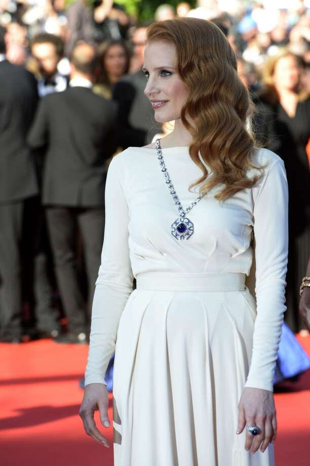 "Jessica Chastain wearing Elizabeth Taylor's sapphire and diamond necklace for the screening of the film ""Cleopatra"" presented in Cannes Classics at the Cannes Film Festival on May, 2013. The sautoir features a 65-carat center stone and was purchased by Taylor's costar and future husband Richard Burton for her 40th birthday. Photo: Anne-Christine Poujoulat, Courtesy Of The De Young And Bulgari"
