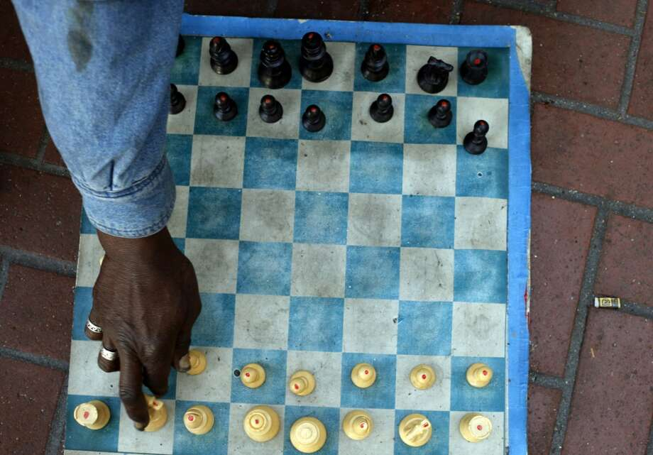 Marvin Boykins, 57, sits between 5th and 6th and Market Street with his chess board, Monday September 16, 2013, in San Francisco. Boykins and his latex chess board are all that remain on Market Street. Photo: Lacy Atkins, The Chronicle