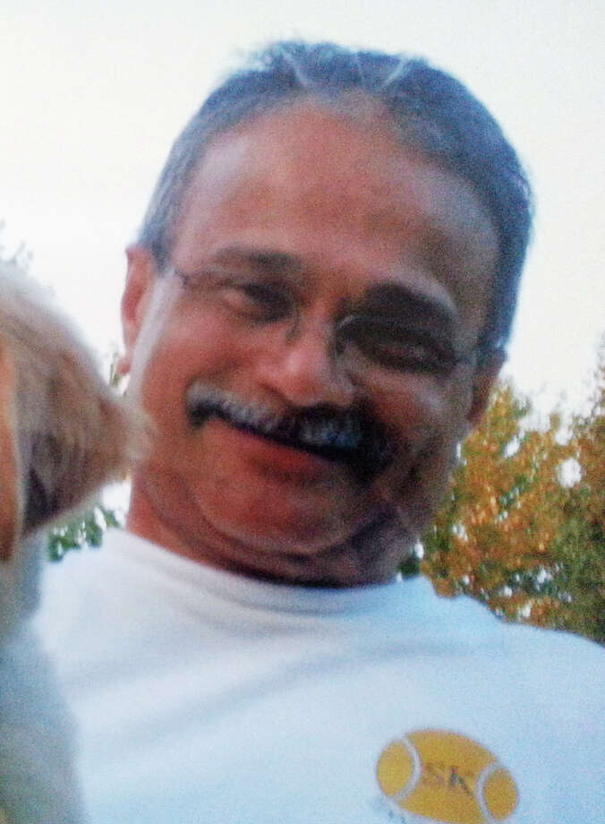 This photo provided by the family of Vishnu Pandit shows the 61-year-old man from North Potomac, Md., who was one of the 12 victims killed in the shooting rampage at the Washington Navy Yard on Monday, Sept. 16, 2013. (AP Photo/Courtesy of the Pandit family) Photo: Uncredited, HONS / Courtesy of the Pandit family