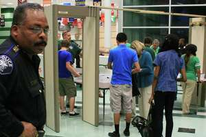 Spring ISD police chief Victor Mitchell watches as students check through metal detectors on the first day of school, Sept. 9.