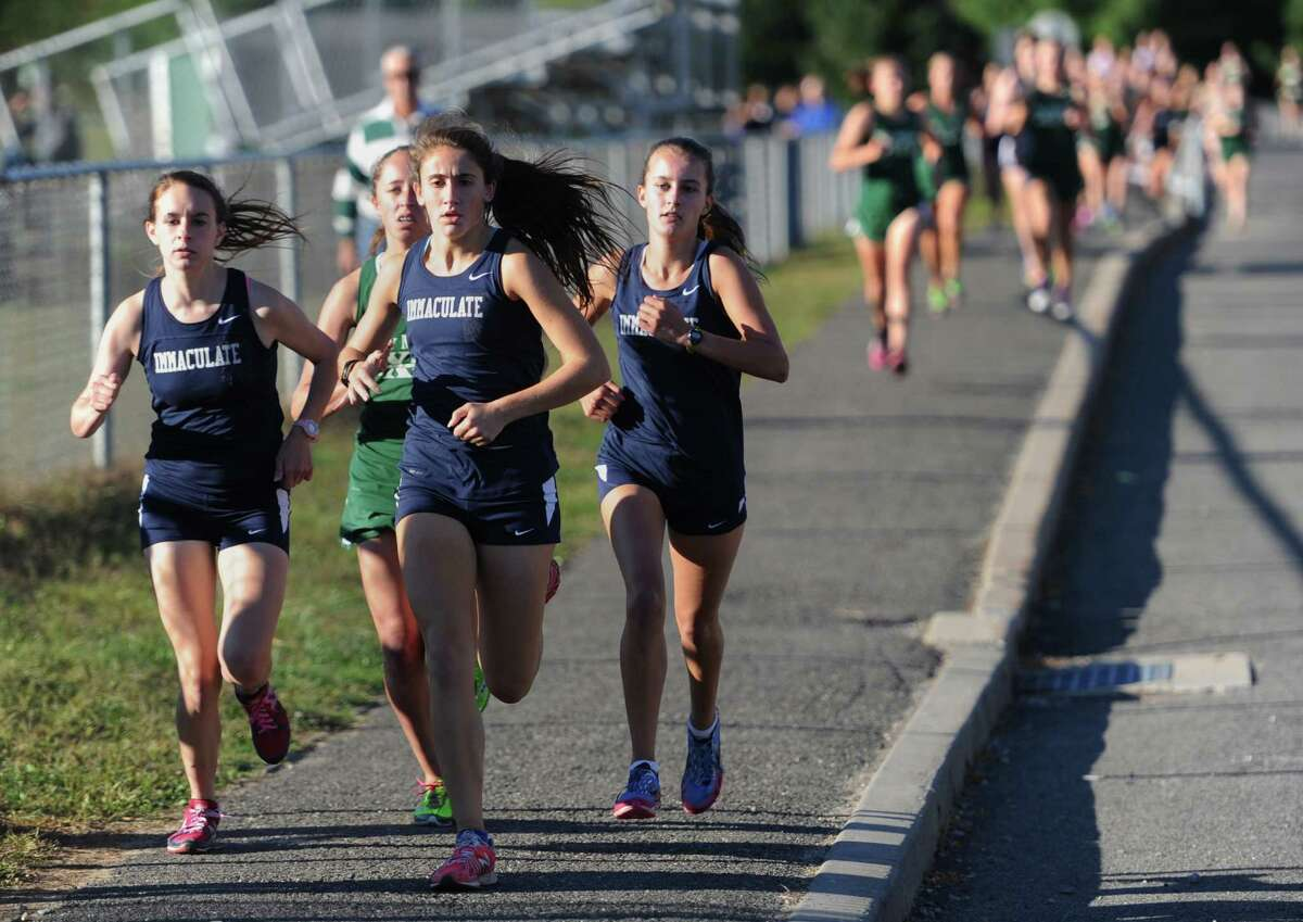 Immaculate girls take an early lead on the field in the girls cross country meet at New Milford High School in New Milford, Conn. on Tuesday, Sept. 17, 2013. Immaculate's Carly Schuyler, center, topped the field, finishing the 3.0 mile course with a time of 18:39. Immaculate also finished first as a team, with New Milford finishing second, Brookfield third and Weston fourth.
