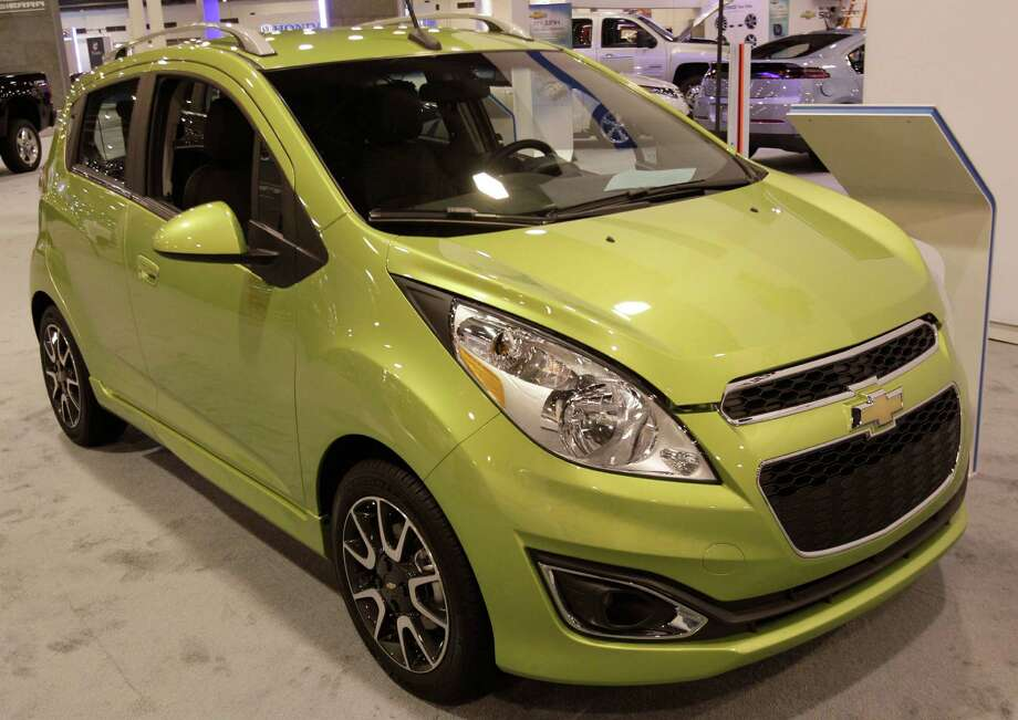 GM now offers the all-electric Chevy Spark, which can go 82 miles on a charge. It starts at $26,685. Photo: Melissa Phillip, Staff / © 2013 Houston Chronicle
