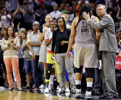 Silver Stars head coach Dan Hughes  (right) greets player Danielle Adams as she walk off the court during second half action against the Atlanta Dream Sunday Sept. 15, 2013 at the AT&T Center. The Silver Stars won 97-68. Photo: San Antonio Express-News / © 2012 San Antonio Express-News