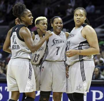 Shenise Johnson (from left), Danielle Robinson, Jia Perkins and Danielle Adams watched as Silver Stars players missed a combined 94 games because of injuries. Photo: Edward A. Ornelas / San Antonio Express-News