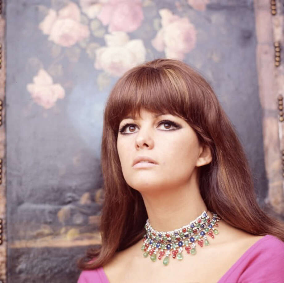 Claudia Cardinale wearing two ruby, sapphire and diamond necklaces in the Dec. 1966 edition of Vogue Italy. Photo: Courtesy Of The De Young And Bulgari