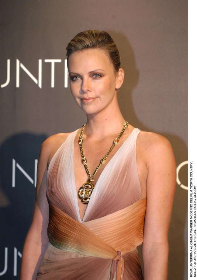 "Charlize Theron wearing a sautoir in gold with yellow sapphire, tiger's eye, citrines and diamonds at the ""North Country"" premiere in Rome, 2006 Photo: Courtesy Of The De Young And Bulgari"