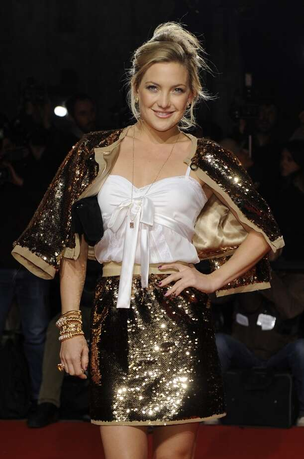 Kate Hudson sporting several Bulgari yellow gold bracelets in yellow gold at the 'Extreme Beauty in Vogue' event in Milan, 2009. Photo: Courtesy Of The De Young And Bulgari