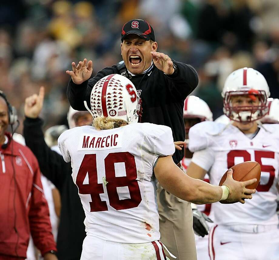 SOUTH BEND, IN - SEPTEMBER 25: Head coach Jim Harbaugh of the Stanford Cardinal jumps to greet Owen Marecic #48 after Marecic intercepted a pass for a touchdown against the Notre Dame Fighting Irish at Notre Dame Stadium on September 25, 2010 in South Bend, Indiana. Stanford defeated Notre Dame 37-14. Photo: Jonathan Daniel, Getty Images