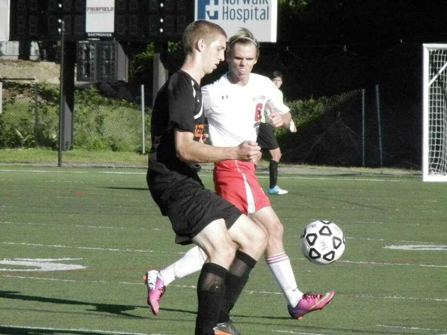 Fairfield Prep junior defender Simon Whiteman challenges a Shelton player in the Jesuits' 1-0 boys soccer loss at Fairfield University's Alumni Field on Tuesday, Sept. 17. Photo: Reid L. Walmark
