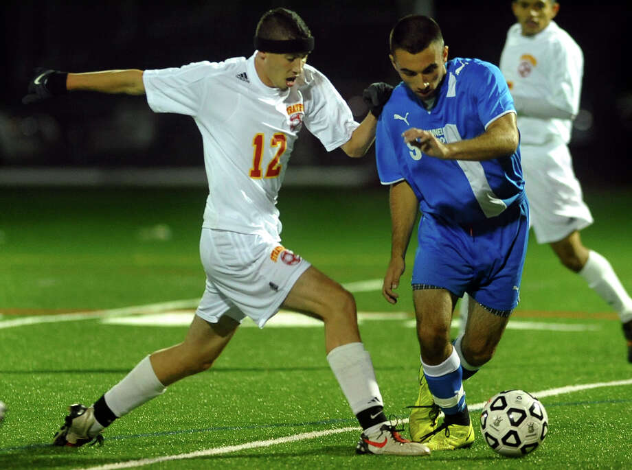 Stratford's Isaiah Fonesca, left, tries to get to the ball before Bunnell's Christopher LaConte, during boys soccer action in Stratford, Conn. on Tuesday September 17, 2013. Photo: Christian Abraham / Connecticut Post