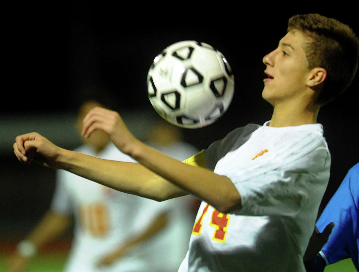 Stratford's Andrew Rios chests the ball, during boys soccer action against Bunnell in Stratford, Conn. on Tuesday September 17, 2013.